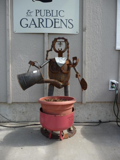 Ron Smith's recycled metal Watering Girl Planter